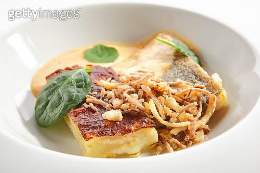 Baked Halibut, Pollock or Cod Fillet with Parsnip Cream Isolated