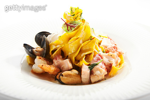 Tagliatelle pasta with seafood closeup view