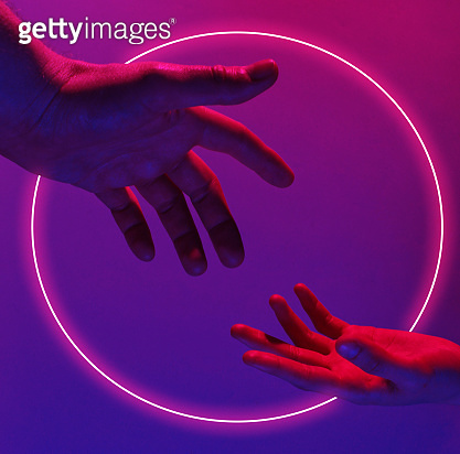 Two hands reach out to each other with a red-blue neon light. Minimalism fashion. Surrealism. Concept art