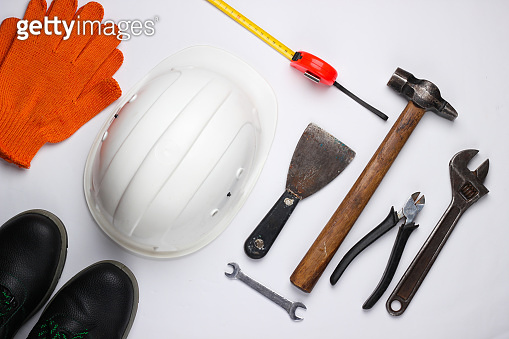 Safety equipment and work tool on a white background. Top view.