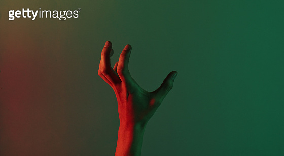 Awesome female hand with blue neon red green light. Halloween theme. Minimalism fashion. Surrealism. Concept art