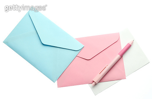 Envelope with a letter and pen isolated on white background.