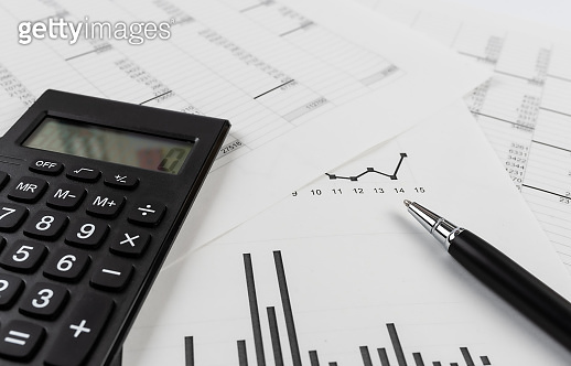 bookkeeping and accounting business concept, calculator and pen on data sheets