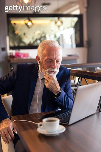 Senior businessman speaking on the phone