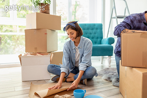 Woman wrapping things for relocation