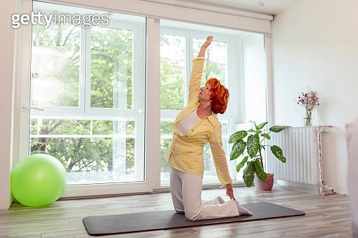Elderly woman doing yoga