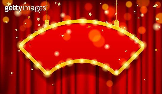 Hanging cambered red signboard with a yellow frame and lights on red curtain under a gold rain