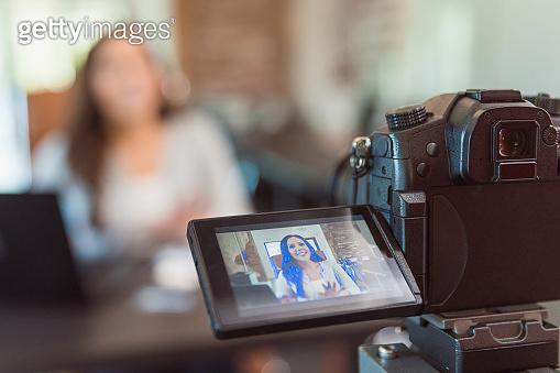 Female influencer addresses audience during vlog