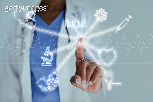 Confident doctor accessing modern technology