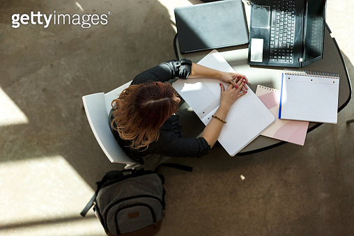 High angle view of woman studying on campus