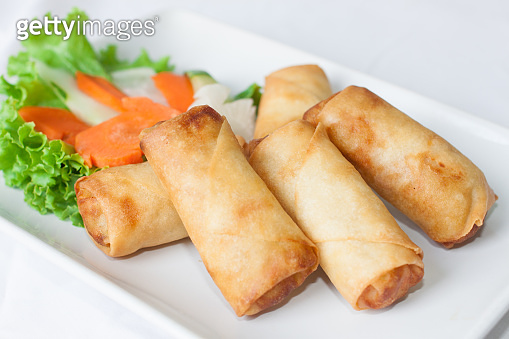 Appetizer for deep fried spring rolls on white dish are Chinese traditional food