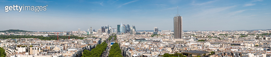 Paris Skyline. Financial District in Paris France. Traffic on La Grande Armee Avenue with Green Trees Aside.