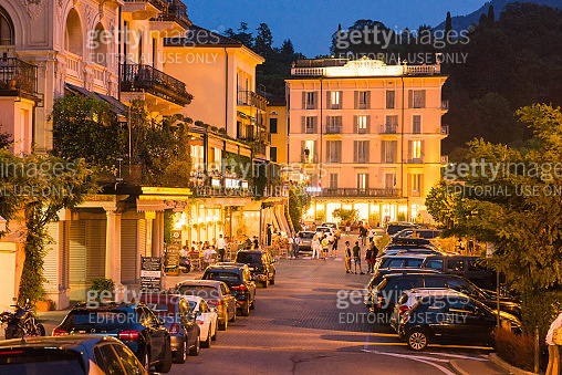 Night Time Street in Bellagio with Tourists, Cars and Lights of Outdoor Lanterns.