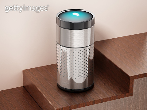 Generic chrome plated smart speaker standing on wood surface