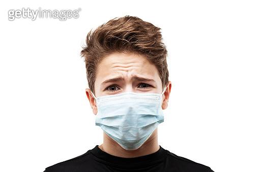 Teenager boy wearing respiratory protective medical mask