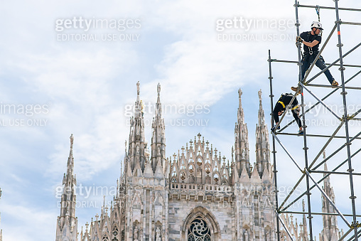 Workers Assemble a Steel Structure in Front of Milan Cathedral. Italy. Stage Construction for Performances.