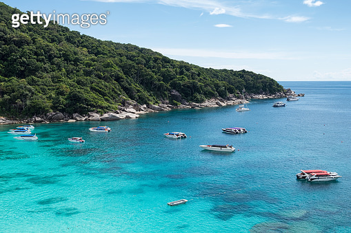Scenery of boats in tropical sea with blue sky on Similan bay