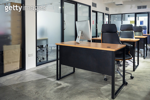 Interior of empty modern office and coworking space temporarily closed and policy for employees to work from home