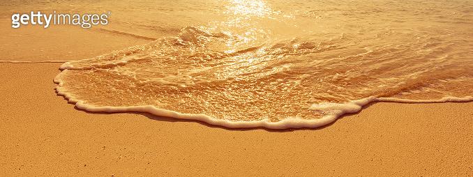small waves splashing on the beach