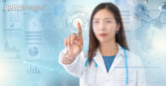 woman doctor defocused behind a digital interface