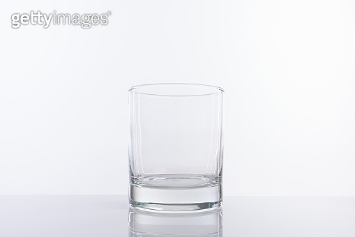 Empty glass cup isolated on white background. For alcohol or cocktails