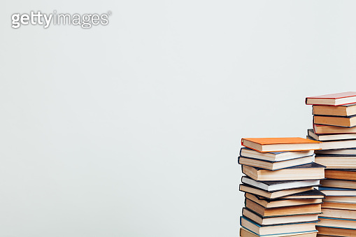 a lot of educational books for exams at the university on the white background of the library