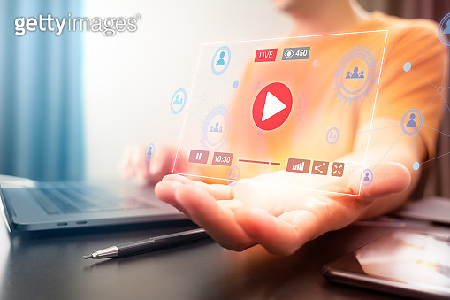 Attractive Asian man using Laptop computer to watching and control live streaming video on a social network. Watch and enjoy online multimedia entertainment content while staying at home.