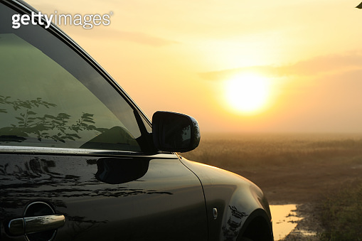 A car near a wheat field in the morning. Beautiful summer morning
