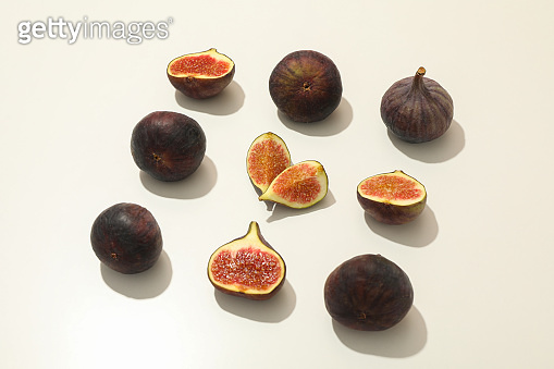 Flat lay with fig fruits on white background