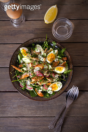 Smocked mackerel fish salad with eggs, arugula and vegetables