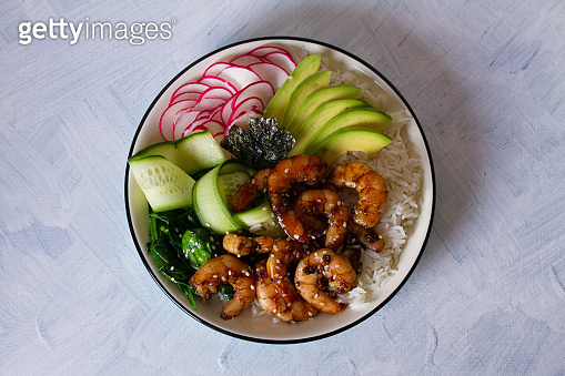 Shrimps prawns with rice, avocado, spinach, radish cucumber and  seaweed