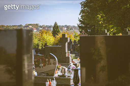 graves in the cemetery in the autumn season