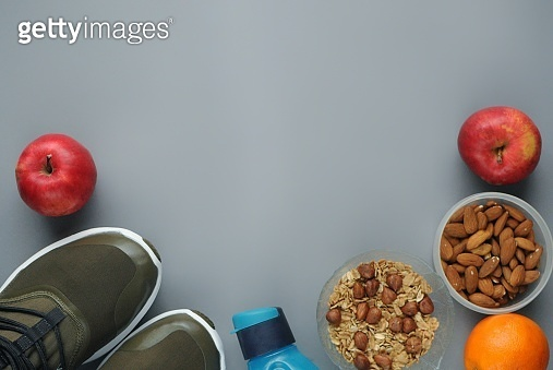 Attributes of a healthy lifestyle: food, sport equipment. Diet snacks.