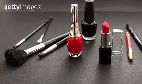 Make-up cosmetics accessories against black background