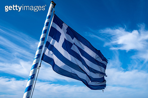 Greek flag waving against blue sky background