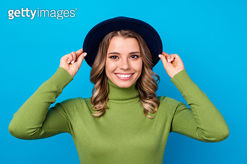 Closeup photo of cheerful pretty curly lady good mood attractive appearance arms touch cool retro cap beaming smile wear hat casual green turtleneck isolated blue color background