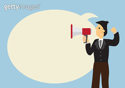 Businessman with a megaphone and a giant speech bubble against a green background. Concept of sales, consumerism or marketing.
