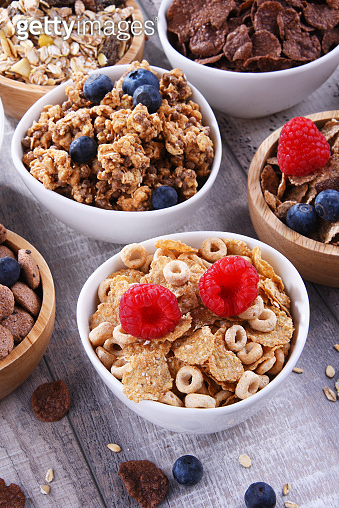 Bowls with different sorts of breakfast cereal products