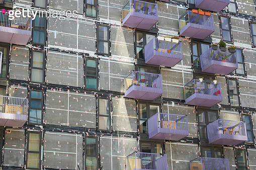 Re-cladding work in progress on a block of flats in Stratford, London