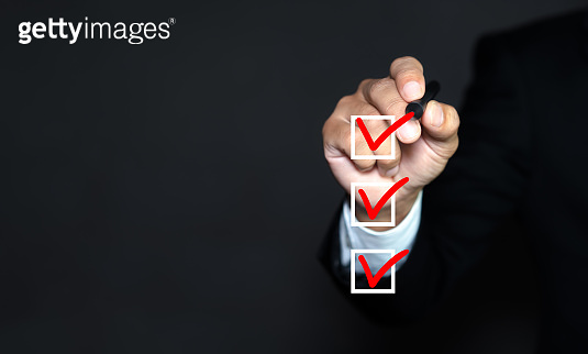 Checklist concept, Businessman checking mark on the checkbox with marker red, copy space