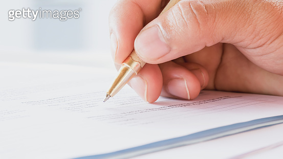 Applicant filling in business company application form document applying for job, or registering claim for health insurance