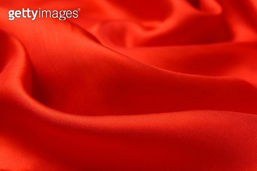 fabric texture. abstract background with soft waves. Smooth elegant red silk or satin luxury cloth