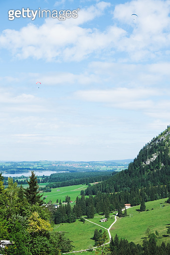 Paragliders in the sky over the houses