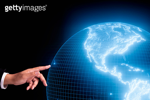 businessman hand point to touch the holographic 3D rendering earth screen technology background, Element of this image furnished by Nasa