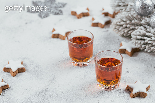 Whiskey, brandy or liquor, cookies and winter holiday decorations on white background