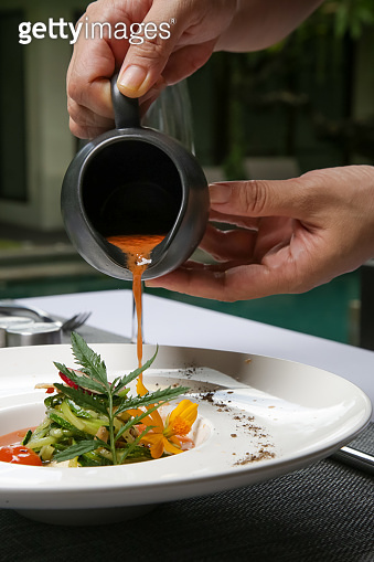 Healthy organic tomato soup. Modern creative restaurant meal. Exquisite dish, haute couture food.