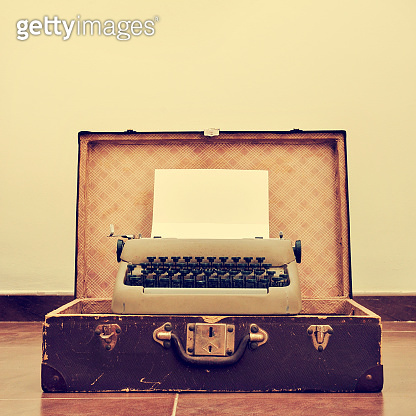 old typewriter in an old suitcase, with a retro effect