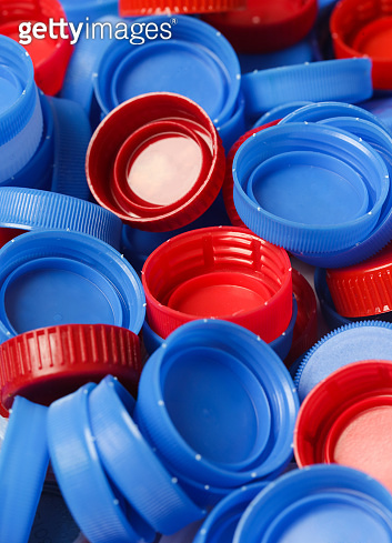 Heap of plastic bottle caps ready for recycling