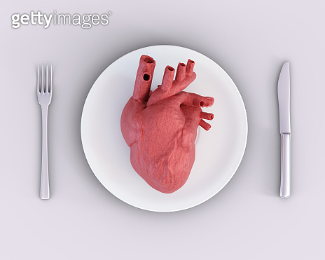 3d illustration of anatomical heart on plate, knife and fork. Concept of toxic relationship, heartbreak, broken heart