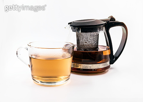 Teapot and cup with tea  on white background